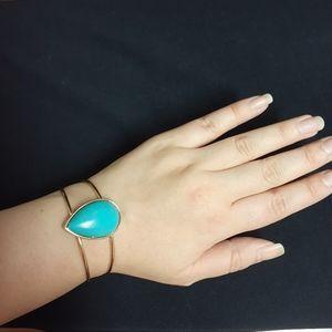 Golden bracelet with big Turquoise stone
